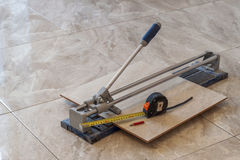 Ceramic tiles and tools for tiler. Floor tiles installation. Hom Royalty Free Stock Image