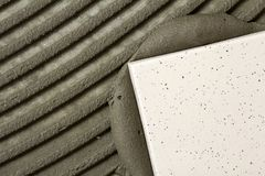 Ceramic tiles and tools for tiler. Floor tiles installation. Home improvement, renovation - ceramic tile floor adhesive.  Royalty Free Stock Photos