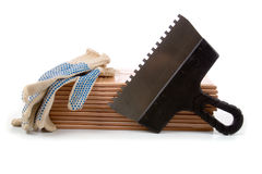 Ceramic tiles and trowel for repairs Royalty Free Stock Photo