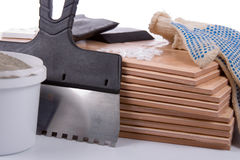 Ceramic tiles and trowel for repairs Royalty Free Stock Images