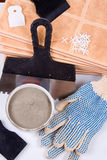 Ceramic tiles and trowel for repairs Stock Photography