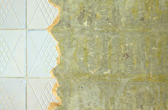 Ceramic tiling on repairing room wall Royalty Free Stock Photography