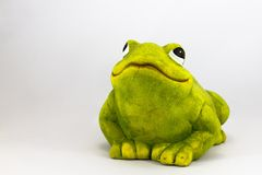 Ceramic toad. Ceramic figure of toad isolated on white background Stock Photo