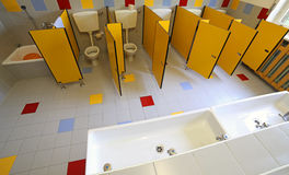 Ceramic toilets and sinks in the bathroom of the kindergarten royalty free stock photos