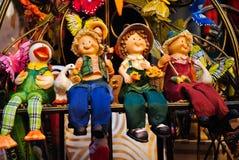 Ceramic toys. Four colourful ceramic toys sitting in line Stock Images