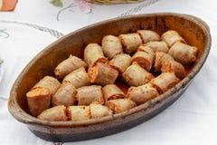 Ceramic tray with chorizo pieces Stock Photo