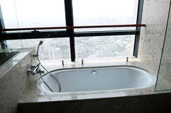 The ceramic tub with sprayer in a hotel Royalty Free Stock Photography
