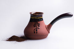 Ceramic turk for coffee lying on gray background. royalty free stock image