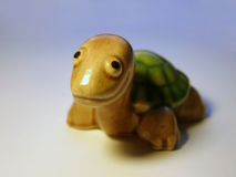 Ceramic turtle. Porcelain smiling turtle figure stock photography