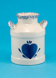 Ceramic vase dish blue heart on blue background Royalty Free Stock Photo