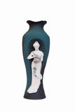 Ceramic vase with a girl figure Royalty Free Stock Image