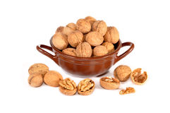 Ceramic vase with walnuts. The ceramic vase with walnuts costs on a table Royalty Free Stock Image