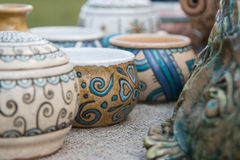 Ceramic vases. Hand painted. Perspective. The background is blurred. Pottery covered with enamel. Stock Photo