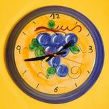 Ceramic wall clock on yellow Royalty Free Stock Photos