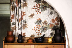 Ceramic ware on the cupboard in the kitchen Royalty Free Stock Image