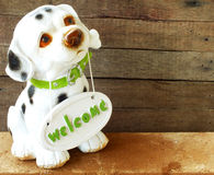 Ceramic welcome dog on wooden background Stock Photography