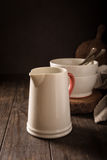 Ceramic white jug with red handle Stock Images