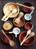 Ceramic, wooden, clay empty handmade bowl, cup and spoon on dark background. Pottery earthenware utensil, kitchenware. Royalty Free Stock Photography