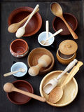 Ceramic, wooden, clay empty handmade bowl, cup and spoon on dark background. Pottery earthenware utensil, kitchenware. Stock Photo