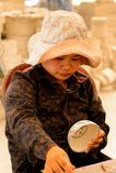 Ceramic workshop. HANOI, VIETNAM - SEP 24, 2014: Unidentified Vietnamese woman draws on the ceramic dish in the ceramic workshop. Ceramic art is very popular in Stock Photo
