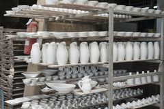 Ceramic workshop in vietri. Internal view of an artistic ceramic workshop of vietri sul mare campania, vases and various objects put to dry before being painted Stock Images