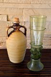 Ceramich pitcher and green wine glass. Ceramich pitcher and green medieval wine glass Royalty Free Stock Photography