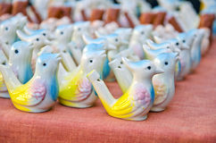 Ceramics bird form   whistles on spring street market Royalty Free Stock Photo