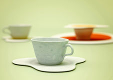 Ceramics cup. Three cups on a green background Royalty Free Stock Image