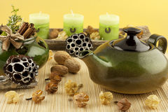Composition with ceramics teapot and oriental candles Stock Photo