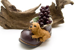 Ceramics Dog On Shoe With Grapes Royalty Free Stock Photos