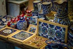 Ceramics, gift shop on Arab market, Old City of Jerusalem. Traditional ceramics dishes and souvenirs in the gift shop on Arab market in the Old City of Jerusalem Stock Photo