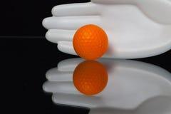 Ceramics hand and golf equipments Stock Photo