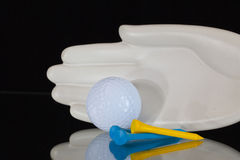 Ceramics hand and golf equipments Royalty Free Stock Image