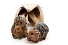 Ceramics hedgehog before nutshell Stock Photos