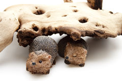 Ceramics hedgehog under tree root Royalty Free Stock Images