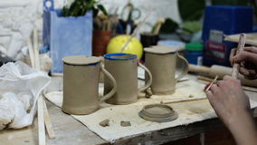 Ceramics. Making the cover for the cup. In the ceramic workshop stock footage