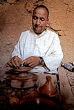 A man berber while working pottery with a lathe in a village in Morocco Royalty Free Stock Images