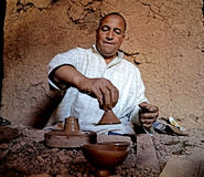 A man berber while working pottery with a lathe in a village in Morocco stock photos