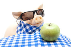 Ceramics pig with apple Stock Photos