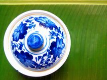 Ceramics pot on banana leaf. Ceramics pot on green banana leaf royalty free stock photo