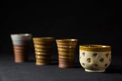 Ceramiczne filiżanki w seriach Obraz Stock