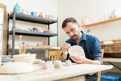 Ceramiczny Biegły obrazu puchar Robić glina fotografia royalty free