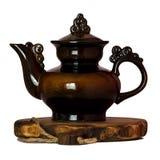 Ceramiczny teapot na drewnianym stojaku Obrazy Stock