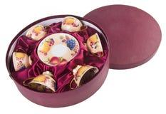 Ceramiki herbaciana filiżanka ustawiająca na tle obraz stock
