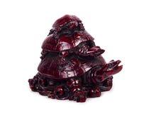 Ceramisch beeldhouwwerk - drievoudige die schildpad op witte achtergrond wordt geïsoleerd Royalty-vrije Stock Foto's