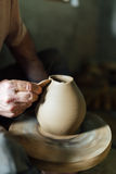 The ceramist make vase from clay Royalty Free Stock Photos