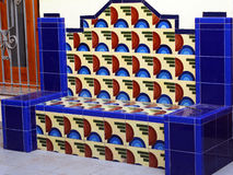 Cerammic bench in blue, red, and white colours. Spain Stock Images