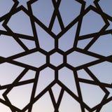 Cerca com um teste padrão floral e estrelas no por do sol Testes padrões e fundos turcos fotografia de stock