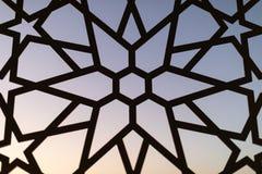 Cerca com um teste padrão floral e estrelas no por do sol Testes padrões e fundos turcos fotografia de stock royalty free