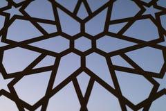 Cerca com um teste padrão floral e estrelas no por do sol Testes padrões e fundos turcos imagem de stock